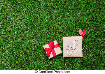 Two little gift boxes with heart shape symbol