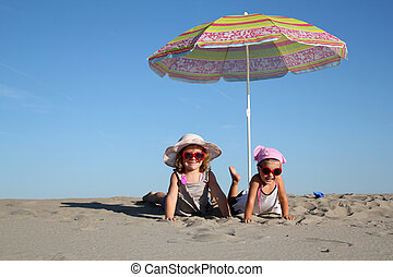 two little girl on the beach
