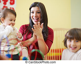 female toddler and 2-3 years girl playing in kindergarten. Horizontal shape, copy space