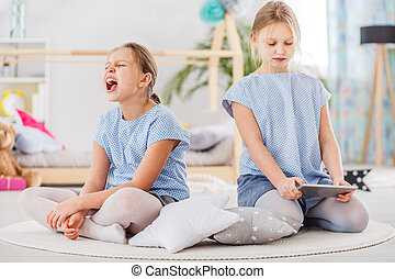 Two little girls arguing