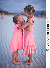 Two little girls at tropical beach in Philippines