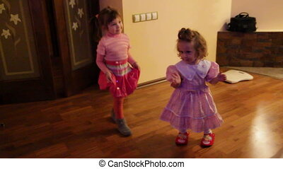 two little girls dancing at home