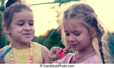 Two Little Girls Girlfriends With Curly Blonde Hair Blue Eyes Eating Ice Cream And Laughing
