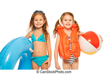 Two little girls going to play in the water