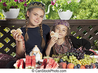 Two little girls have breakfast at chaikhana