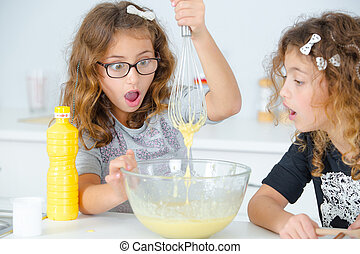 Two little girls having fun baking