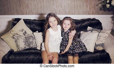 Two little girls hugging - Two little cute girls hugging