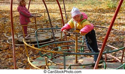 girls playing on playground - two little girls playing on...