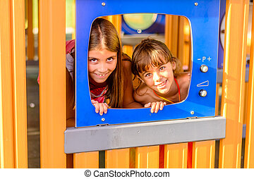 Two little girls playing on the playground