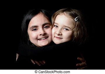 Two little girls posing