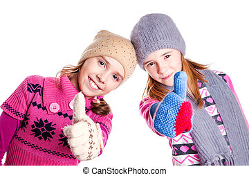 Two little girls showing the thumbs up