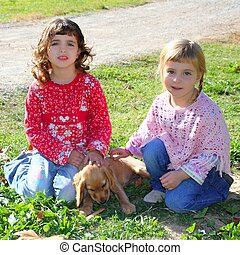 two little girls sister friends golden retriever puppy dog