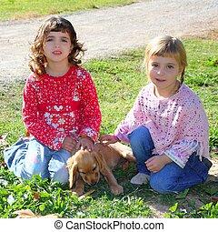 two little girls sister friends golden retriever puppy dog