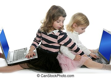 two little girls sister with computer laptops
