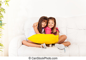 Two little girls with pillows