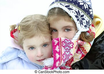 Two little girls with woolen winter hat