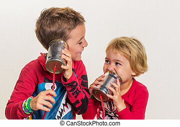 two little kids calling with a phone of two cans.