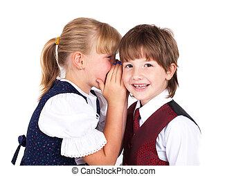 Two little kids telling secrets