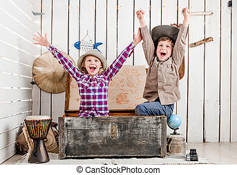 two little laughing children with hands up