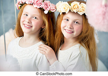 Two little redhead sisters together
