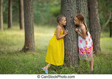 Two little sisters standing talking