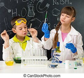 two little students on chemistry lesson in lab