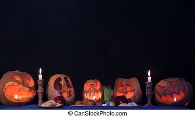 Two Little Witches Doing Magic Over Pumpkins At Halloween