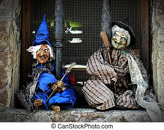 Two little witches in the window