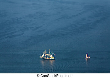 Two lonely sailboats in the middle of the sea. View from the...