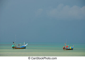 two longtail boat in the sea