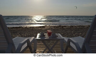 Two loungers on sandy summer beach