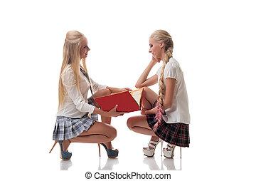 Two lovely blond schoolgirls posing in studio