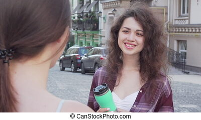 Two lovely female friends talking while sightseeing. Young...