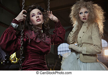 Two lovely women in beautiful dresses