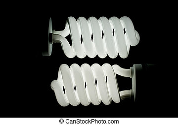 Two low energy spiral light bulbs illuminated