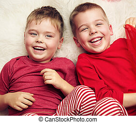Two lying and laughing boys