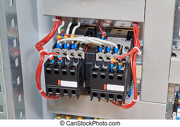 Two magnetic contactor connected in reverse starting Assembly.