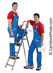 Two male decorators wearing matching outfits