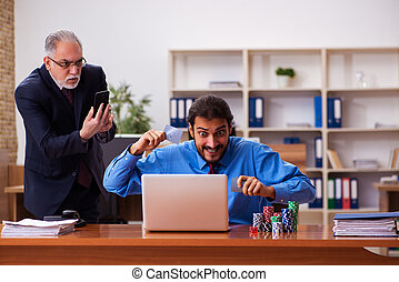Two male employees in gambling concept