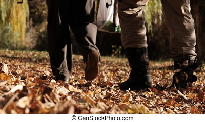 Two Male Fishermen with Fishing Rods Walking in Autumn Park ...