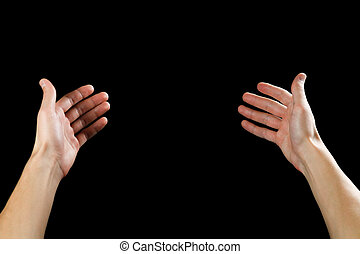 Two male hands on a black background. Close up.
