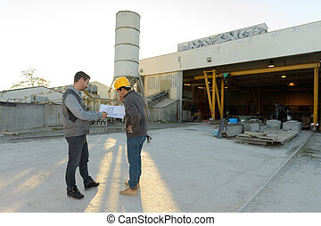 two male hardware store workers working in the yard