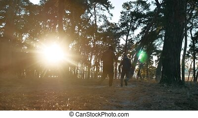 Two male men athletes running lifestyle around in the nature...