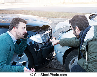 Two man arguing after a car accident on the street
