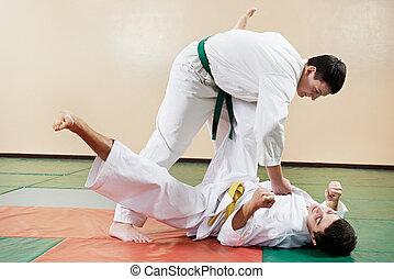 Two man at taekwondo exercises