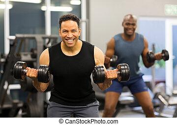 two man doing dumbbell exercise
