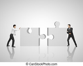 two man puts puzzle