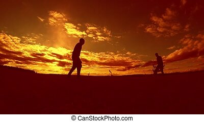 two man soccer player playing with ball during sunset...