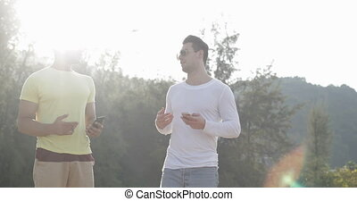 Two Man Talking In Park, Gay Couple Communication Outdoors...