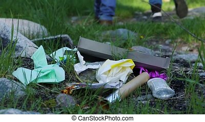 Two man walk away leaving garbage dump in the forest Environmental problem very cinematic, Educational
